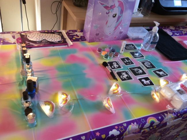 Table set up ready for unicorn glitter tattoos